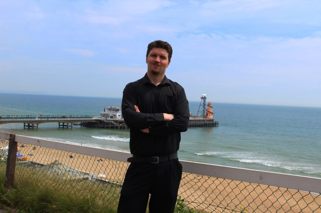 If you're having your author headshots done outside, make sure they take advantage of the backdrop available. Such as the Bournemouth landscape in this case.